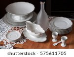 white table set with cups for... | Shutterstock . vector #575611705