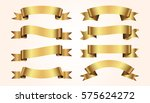 set of golden ribbons on beige... | Shutterstock .eps vector #575624272