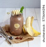 banana chocolate smoothie with... | Shutterstock . vector #575644396