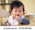 baby girl eating  vegetable... | Shutterstock . vector #575645968