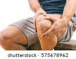 Man With Knee Pain Over White...