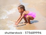 happy young girl playing in the ... | Shutterstock . vector #575689996