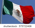 Mexican Flag Flying In A Blue...