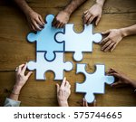 Stock photo group of people holding puzzle pieces concept 575744665