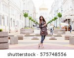 beautiful woman walking in the... | Shutterstock . vector #575748556
