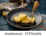 fresh pineapple sliced on plate ... | Shutterstock . vector #575761696