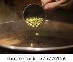 hop addition into a beer   Shutterstock . vector #575770156