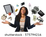 Small photo of African American businesswoman juggling many objects and feeling overwhelmed