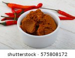 spicy chili paste with peppers... | Shutterstock . vector #575808172