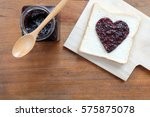 toast with jam in shape of... | Shutterstock . vector #575875078
