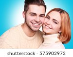 young couple posing on color... | Shutterstock . vector #575902972