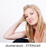 beautiful young lady with long hair with sneer - stock photo