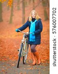 happy active woman riding bike... | Shutterstock . vector #576007702