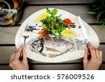 Cooked Fish On White Plate In...