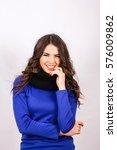 beautiful girl in a blue dress   Shutterstock . vector #576009862