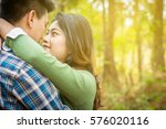 couple embraces on the road.... | Shutterstock . vector #576020116