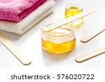 wax for depilation on white... | Shutterstock . vector #576020722