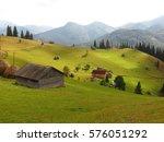 Old Wooden Hut And Haystacks O...