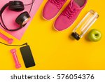 fitness accessories on yellow... | Shutterstock . vector #576054376