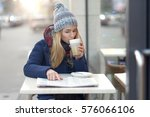 young woman in hat and winter... | Shutterstock . vector #576066106