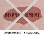 Small photo of Strikethrough word Disparagement written on pink background