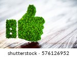green thumbs up sign on blurred ... | Shutterstock . vector #576126952