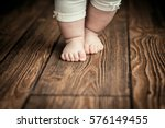 baby feet doing the first steps.... | Shutterstock . vector #576149455