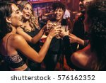group of friends partying in a... | Shutterstock . vector #576162352