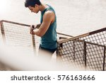 young man checking progress on... | Shutterstock . vector #576163666