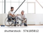 serious physical therapist... | Shutterstock . vector #576185812