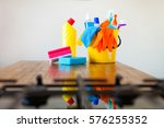 basket with cleaning items on... | Shutterstock . vector #576255352