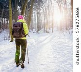 hiking in winter forest with... | Shutterstock . vector #576275686