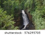 A waterfall runs through a dense forest at Voyageurs National Park in Minnesota