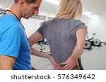 Sport Woman With Back Pain In...