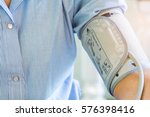 woman checking blood pressure... | Shutterstock . vector #576398416