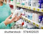 woman in shop chooses deodorant ...   Shutterstock . vector #576402025