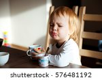 child looks with disgust for... | Shutterstock . vector #576481192