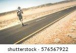 man walking on the road on... | Shutterstock . vector #576567922
