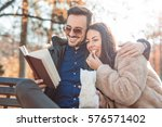 loving couple sitting on the... | Shutterstock . vector #576571402