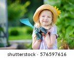adorable little girl wearing... | Shutterstock . vector #576597616