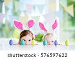 two cute little sisters wearing ... | Shutterstock . vector #576597622