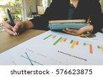 working woman hand holding pen... | Shutterstock . vector #576623875