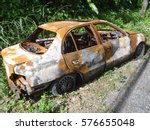 abandoned rusty car wreck | Shutterstock . vector #576655048