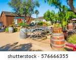 wooden barrels and cart in old... | Shutterstock . vector #576666355