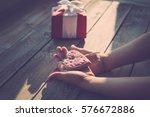 children's hands hold cookies...   Shutterstock . vector #576672886