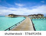 wooden water bungalows  maldives | Shutterstock . vector #576691456
