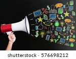 hand holding megaphone with... | Shutterstock . vector #576698212
