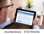 person filling online survey... | Shutterstock . vector #576750256