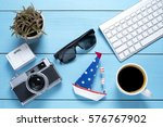 old camera with sunglasses and... | Shutterstock . vector #576767902