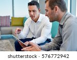 two focused male work... | Shutterstock . vector #576772942
